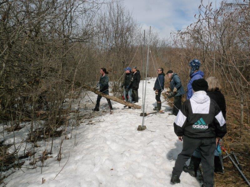 Volunteers helping with habitat management on a partly sunny but still snowbound day early this week (Photo by Marcel Gahbauer)